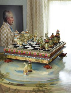 A new spin on checks on this amazing chess board! Each chess piece is made by hand and fired four times with 23 carat gold details. The elaborate base also serves as storage for the chess pieces. Love the ceramic turtle feet and leaping rabbit knights! Completely made by hand.