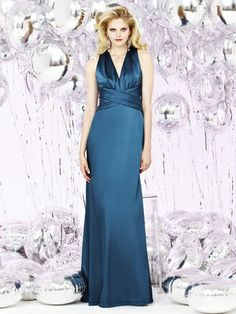 Dessy Social Bridesmaid style 8127 is a Full length stretch charmeuse halter neck dress w/ criss cross shirred detail at bodice and trumpet skirt.