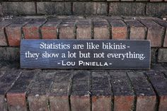 Statistics are like bikinis - they show a lot, but not everything -- Lou Piniella  #sports #statistics #woodsign #customsign #favoritequotes #baseball #signsbyandrea