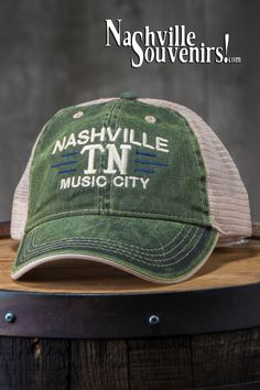 592de7049d9b09 A new washed green Nashville TN Music City Trucker Hat featuring an  embroidered logo that reads