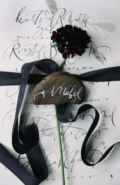 calligraphy rocks - photo by Tulip and Rose Photography http://ruffledblog.com/annabel-lee-wedding-inspiration #namecard #escortcard