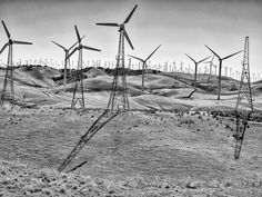 roseannadana: Back on my home turf posted a photo:  Tehachapi Pass Wind Farm Hills & Turbines. Wind Turbines began being built here in the 1980's and stood between 45 and 60 feet high. They now reach up to 400 and 500 feet high producing from 1 to 2.4 megawatts of power. There are multiple generations of turbine technology here including single, double and triple blade turbines. With over 4,700 turbines this is the second largest wind farm in California.  You can hike and tour the park and…