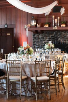 Dining area decorated in blush, creams and corals.  Reception at the Corinthian Yacht Club.