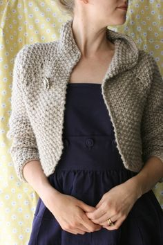 Snowdrift is a slouchy women's shrug with curved edges shaped with short rows. Worked from the top down with a raglan yoke, the chunky singles yarn knits up quickly in seed stitch.