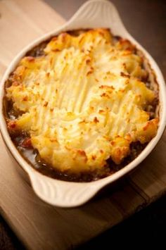 "The name 'Shepherd's Pie' was first used in the 1870's,an older name is ""cottage pie"".Today the dish is ""shepherd's pie"" if it is made with lamb (because a shepherd looks after sheep).The name 'Cottage Pie' is used if the dish is made with minced beef. Both have a savory gravy with a mashed potoato crust.The term cottage pie is known to have been in use in 1791,when the potato was being introduced as an edible crop affordable for the poor (""cottage"" meaning a modest dwelling for rural worker..."