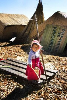#Travel #Photo of the Day: Little Girl and Her Floating Island in #Peru