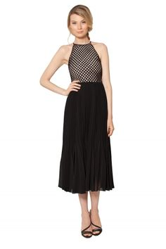 A shoulder-bearing neckline and a midi length skirt are combined in the Pheobe Pleated Lattice Dress...from Raoul.