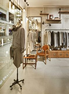 Vintage Industrial Charm Defines New Fashion Clothing Store in Moscow - http://freshome.com/vintage-industrial-charm-defines-fashion-clothing-store-moscow