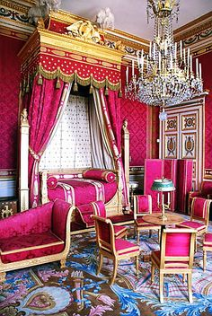 Napoleon's hot pink and gold bedroom at the Palace of Comiegne