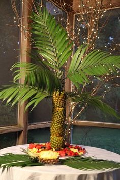 Have the hottest summer party on the block with this Pineapple Palm Tree and my Pina Colada Fruit Dip! EASY how to instructions to make the Pineapple Palm Tree Centerpiece.    http://makelifespecial.com/pineapple-palm-tree-centerpiece-ideas/