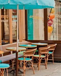Turquoise chairs/cafe in Paris  by Georgianna
