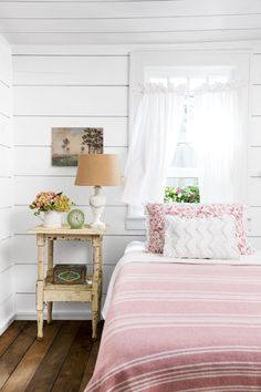 In Guest Bedroom #1, rustic shiplap walls are the perfect foil to the sweet pink, red, and white color scheme Cindy chose for all three bedrooms.