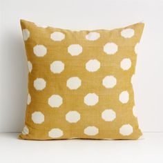 To craft this mustard polka-dotted pillow, artisans print pure cotton threads with pigment before weaving them into a slub-textured fabric by hand. This traditional ikat method creates distinctive blurred edges on the pale circles and organic washes of color. Our decorative pillows include your choice of a plush feather-down or lofty down-alternative insert. Reversing to the same cheerful pattern, the Anellis golden yellow polka dot pillow is a Crate and Barrel exclusive.     Handwoven  100%… Yellow Pillow Covers, Yellow Pillows, Boho Pillows, Throw Pillows, Century Textiles, Pillow Arrangement, Golden Yellow, Crate And Barrel, Crates