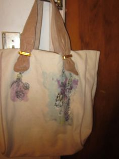 JUICY LARGE TOTE  CLOTH W. LEATHER  HANDLES  $75.00