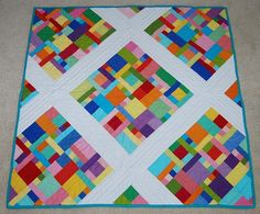 Tutorial for making the blocks for this quilt is here: http://slw71881.wordpress.com/2012/09/10/baby-quilt/