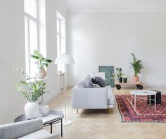 A simple grey and white sitting room area in a magnificent Finnish apartment / Bo LKV & Marja Wickman.