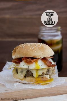 Bacon and #EGG Burgers - A seasoned burger patty is topped with bacon and eggs for this burger with a breakfast twist!