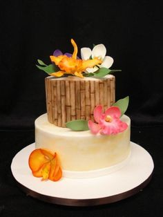 Orchid Bamboo - Buttercream cake with gumpaste orchids.  Bamboo don out of silicone mold then airbrushed.
