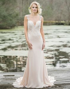 Lillian West lillian west style 6454 Show off your figure in this sexy chiffon and tulle gown featuring an illusion Sabrina neckline, cutout illusion sides, low back, and sweep train.