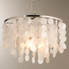 """This beautiful chandelier has a Satin Nickel finish to complement rows of dangling Capiz shells. Pair this chandelier with modern or transitional home decor pieces for a glamorous look. 3x60 watt medium base lamp. (18.5""""Hx19.75""""W). Supplied with 6' of chain and 16' wire."""