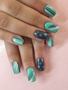 Mint of spring gelish with charcoal grey glitter and feather and polka dot nail art