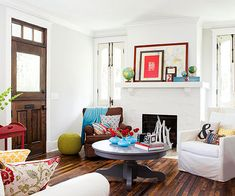 Fresh white paint and a new tile hearth refreshed the fireplace in this living room's makeover: http://www.bhg.com/decorating/fireplace/styles/before-and-after-fireplaces/?socsrc=bhgpin110314charminglyeclectic&page=5