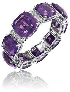An Amethyst and Diamond Bracelet. Designed as a series of alternating cushion-cut amethysts spacers