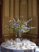 Tall wedding centerpieces with white, green and purple flowers.PNG