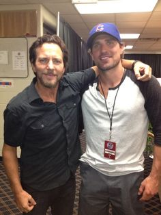Eddie Vedder and Patrick Sharp Wrigley Field.....i dont know who Patrick Sharp is, but he looks pretty hot....I hardly notice Eddie...which is new to me