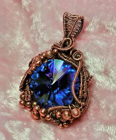 """Wirework /  wire weaving makes this rivoli pendant just a little bit more than ordinary.  I call this piece of jewelry """"Enchanted""""."""