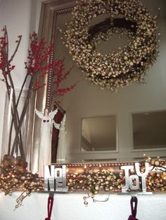Furniture and Accessories. Beautiful Minimalist Christmas Mantel Decoration Ideas with Nice Red and White Berries, Lovely Handmade Wreath, and Gorgeous White Angel Sculpture. Beautiful, Lovely Holiday Fireplace Mantel Decorating Ideas