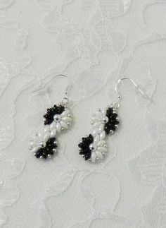 Black & white is classic! These pretty earrings are so cute & classy!!!! I used Jet and White Luster Super Duo beads to make these pretty flowers that have a 4mm silver plated bead in the center. I used 925 Sterling Silver to hang them on. Most of my earrings are pictured with earwires
