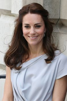 Duchess Of Cambridge: Hair Style File | She chose tumbling curls in a half-up-half-down style for a visit to the Anna Freud Centre in London, of which she is a patron - May 4, 2016