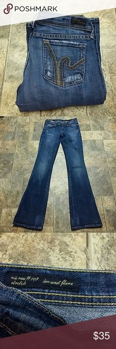 """Citizens of Humanity """"Ric Rac"""" Flare size 25 Citizens of Humanity """"Ric Rac""""  Low waist Flare size 25, inseam 33. Distressed, excellent condition. First picture for reference, jeans are a lighter wash as in last 3 pics. Citizens of Humanity Jeans Flare & Wide Leg"""