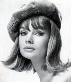 1960s model Jean Shrimpton, with the very popular hairstyle called a Flip, achieved by curling your hair with emptied frozen oj cans.