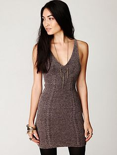 Chenille body-conscious tank dress. Low neckline in front. Two cable knit lines running down front and back.