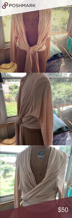 J Jill wrap Beautiful J Jill wrap , natural color with pretty , delicate knit work throughout .... very light weight sweater wrap with long tie which can wrap in front or back , very versatile.... great with jeans , dresses , even yoga gear ! In perfect shape ! J Jill Sweaters