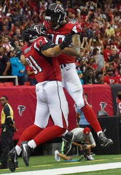 Atlanta Falcons tight end Austin Hooper (81) celebrates his touchdown with Atlanta Falcons tight end Levine Toilolo (80) against the Carolina Panthers during the second half of an NFL football game, Sunday, Oct. 2, 2016, in Atlanta.
