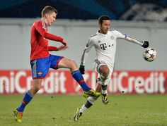 Pontus Wernbloom (L) of PFC CSKA Moscow in action against Thiago Alcantara of FC Bayern Muenchen during the UEFA Champions League Group D match between PFC CSKA Moscow and FC Bayern Muenchen at the Arena Khimki Stadium on November 27, 2013 in Khimki, Russia.