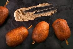 This mini beer-and-sausage corn dog recipe merges pigs in a blanket with corn dogs.