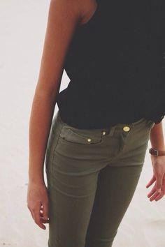 Olive green skinny jeans, Black sleeveless Blouse