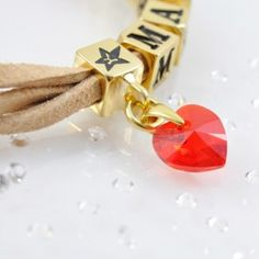 The MAYBE bracelet with SWAROVSKI ELEMENTS crystal heart pendant and cube with 4 crystal, gold version http://store.lovya.net/letters-from-your-heart-lovya/354-bransoletka-mabey-charm-wiszacy-i-charm-z-4-krysztalami-swarovski-elements-wersja-zlota.html