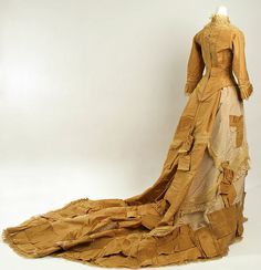 Yellow silk wedding ensemble (back), American, 1877. Worn with white leather high-button boots and cotton petticoat.
