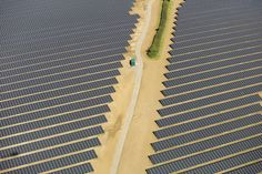 Solar panels sit in an array at the Southwick Estate Solar Farm, operated by Primrose Solar, near Fareham, U.K.  Photographer: Simon Dawson/Bloomberg