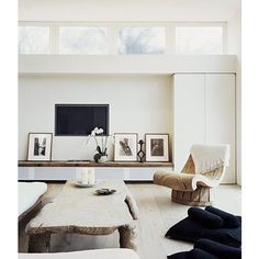 A Gorgeous Living Room via The Style Files #thestylefiles #naturalwoods #livingroom #white #wood #neutrals #organic #tvdisplay #neutralpalette #woodencoffeetable #carvedwood #woodendetail #livingarea #interiors #woodenfloorboards