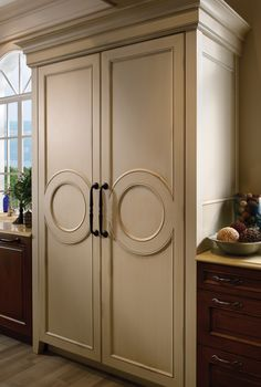 Medallion Inserts for Tower Refrigeration | Wood-Mode | Fine Custom Cabinetry