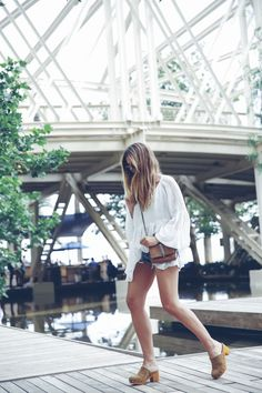 Trendy Taste – Day with friends. White blouse+denim shorts+suede clogs+brown shoulder bag. Summer outfit 2016