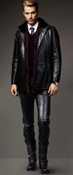 All you need is leather. Black Suit, cashemire cardigan and boots.