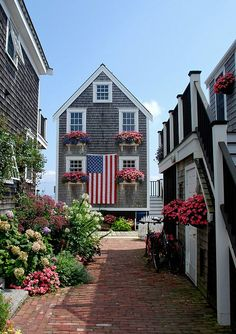 a beach house is not complete without lots of flowers and a big flag