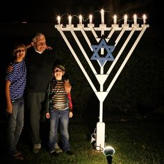 My 80-something dad's giant lawn menorah kicked some #Hanukkah butt this year. I'm a little jealous of it actually.  We didn't get around to crafting one this year but I think we can see the glow from his in our neighborhood too.